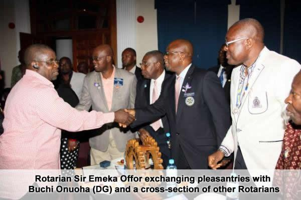 1. rotarian sir emeka offor exchanging pleasantries with buchi onuoha (dg) and a cross-section of other rotarians