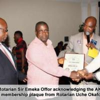 8. rotarian sir emeka offor acknowledging the aks membership plaque from rotarian uche okafor